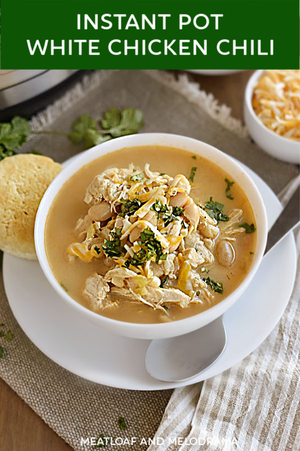 close up of white chicken chili in a bowl for pinterest