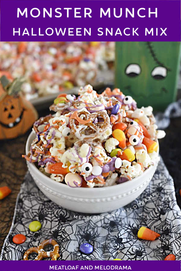 monster munch halloween snack mix made with popcorn and pretzels and candy in a white bowl