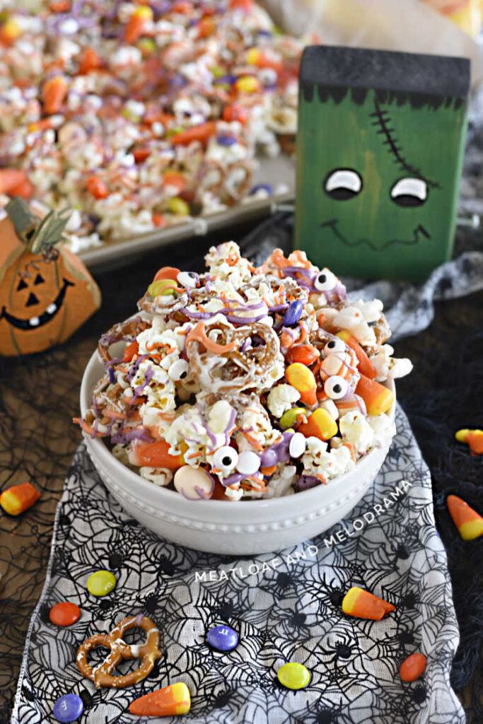 halloween popcorn snack mix with pretzels and candy in a bowl