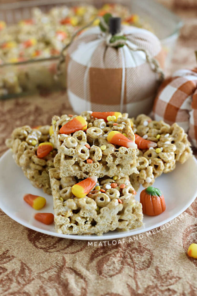 pumpkin spice cheerios marshmallow treats with candy corn and sprinkles on a plate