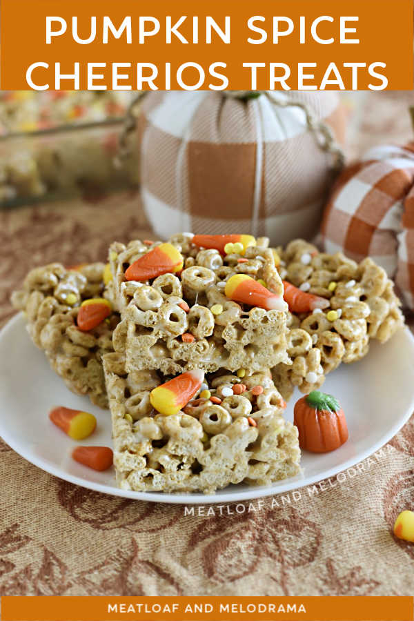 Pumpkin Spice Cheerios Treats with candy corn and fall candy on a plate with pumpkins