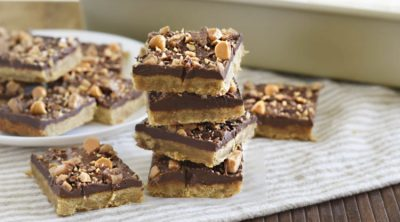 toffee bars with shortbread crust and chocolate butterscotch chips stacked up
