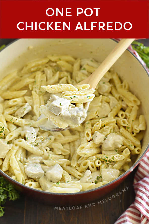 close up of one pot chicken alfredo penne pasta on a wooden spoon