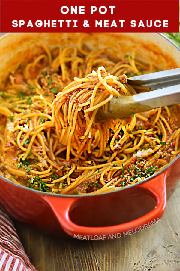close up of spaghetti noodles and meat sauce in dutch oven