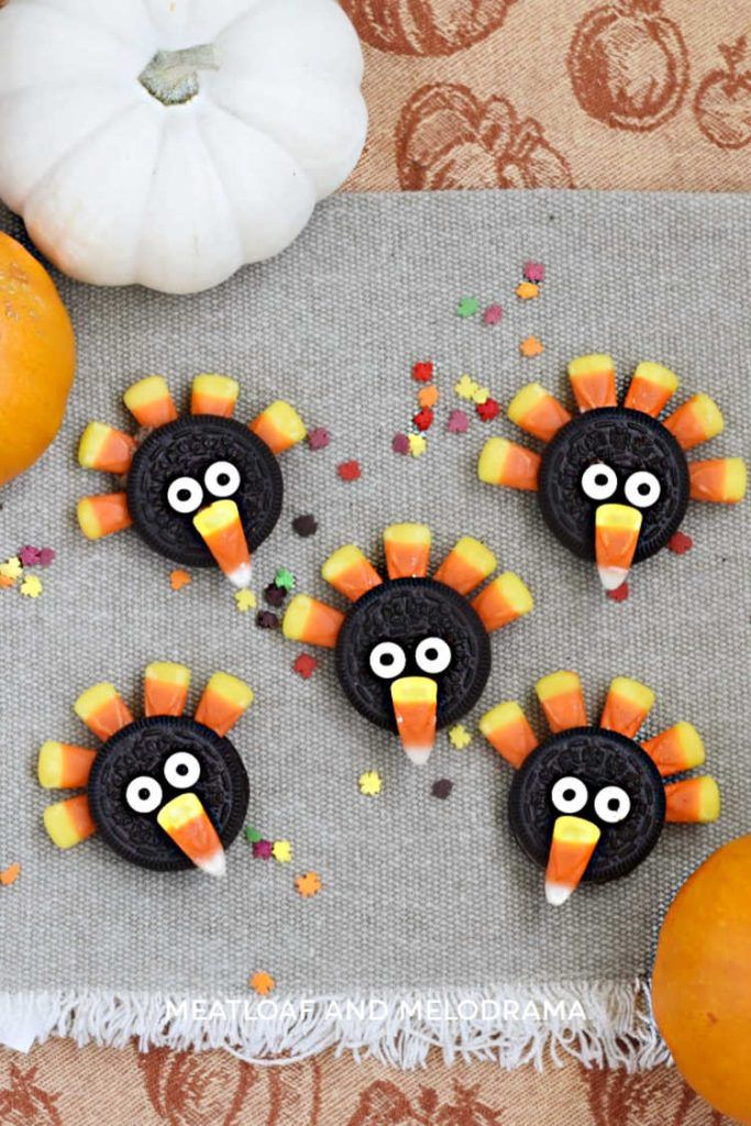 turkeys made from oreo cookies and candy corn on a thanksgiving tablecloth