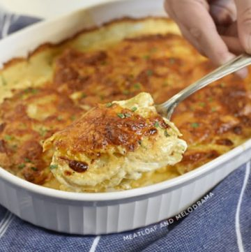 potatoes au gratin on a serving spoon
