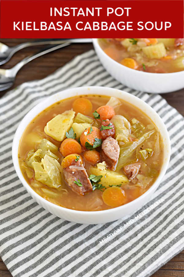 instant pot kielbasa cabbage soup with carrots and potatoes in a white bowl