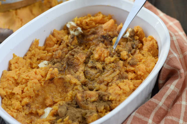 mashed sweet potatoes with butter and brown sugar in casserole dish