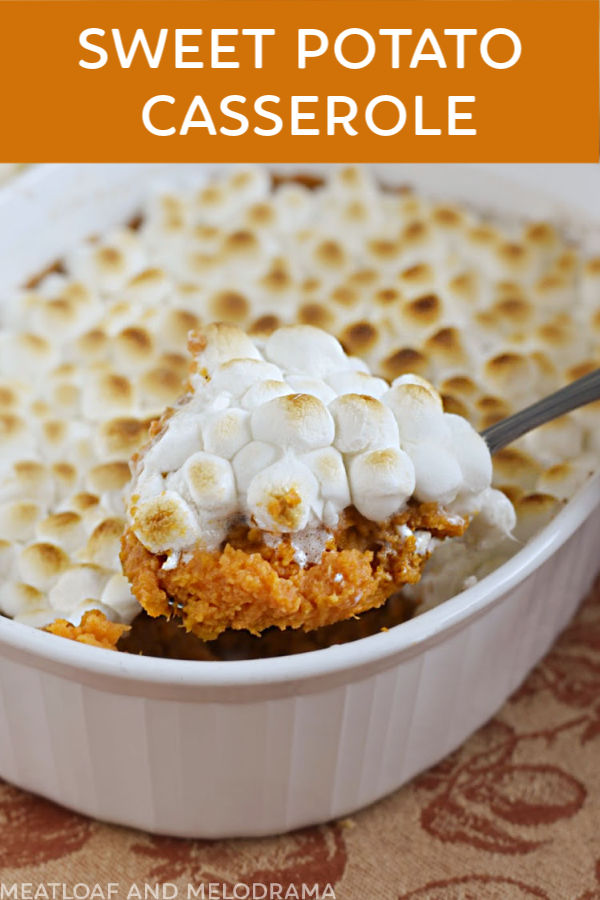 close up of sweet potato casserole with marshmallows on spoon
