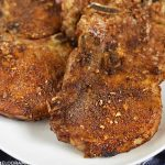dry rubbed air fryer pork chops on a platter