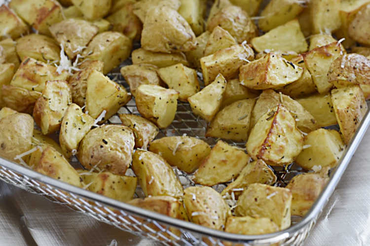 air fried potatoes with parmesan in air fryer basket