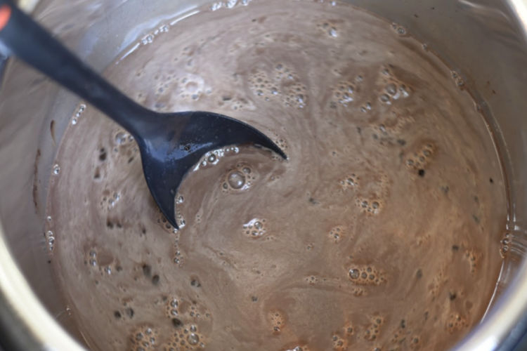 mixing cream and cocoa in the instant pot