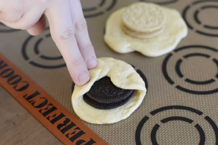 fold crescent dough over oreo