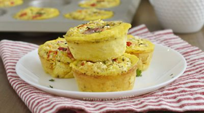 ham and egg muffins with peppers and cheese on a plate