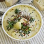 bowl of instant pot zuppa toscana with bacon and parmesan cheese