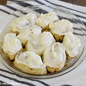cinnamon rolls made from 2 ingredient dough with cream cheese frosting in a pie pan