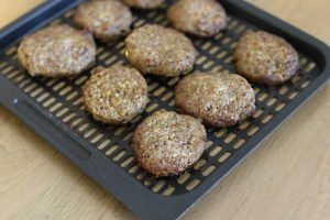 cooked breakfast sausage patties on air fryer tray