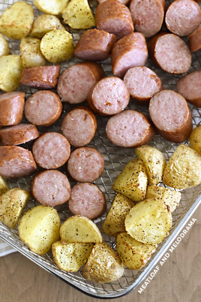 cooked kielbasa and potatoes in metal tray