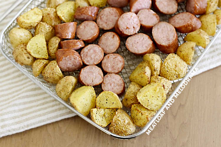 sliced air fried kielbasa and potatoes in basket