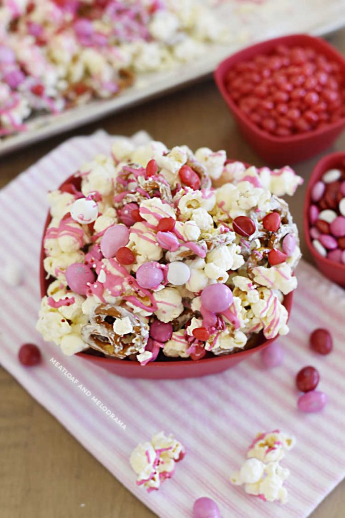 bowl of valentine's day popcorn with red and pink candies