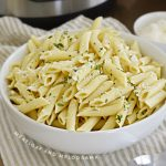 bowl of penne pasta with parmesan cheese
