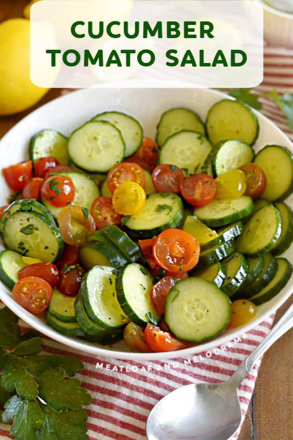 Cucumber Tomato Salad with a light lemon dressing is a super easy side dish that takes minutes to make. Enjoy this refreshing salad recipe all summer long!