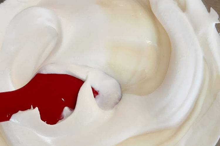 fold whipped cream into sweetened condensed milk