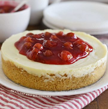 instant pot cheesecake with graham cracker crust and cherry pie filling on top