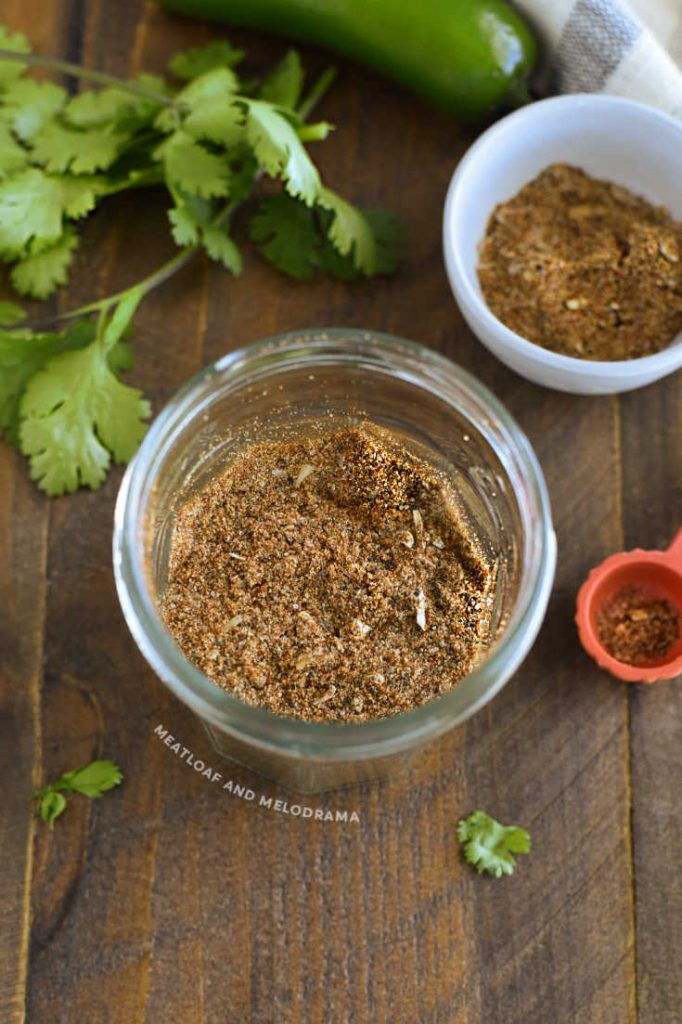overhead view of homemade spice mix for tacos in glass jar
