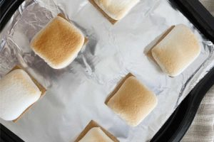 broiled marshmallows over graham crackers on baking sheet