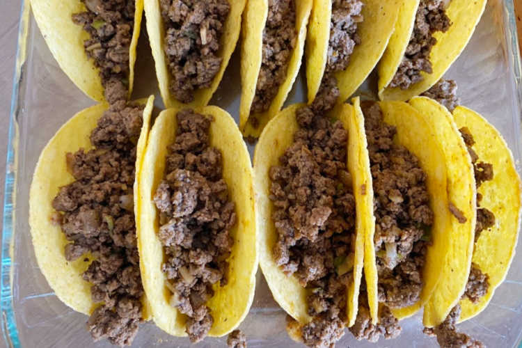 ground beef inside hard corn taco shells