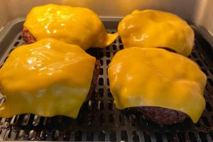 melted American cheese over burgers in Instant Pot vortex plus