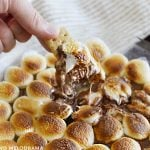 dip graham cracker into easy s'mores dip