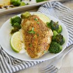 baked honey lime chicken with broccoli and rice on a plate