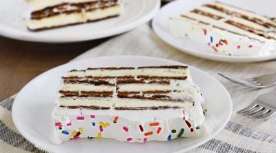 sliced ice cream sandwich cake on white plates