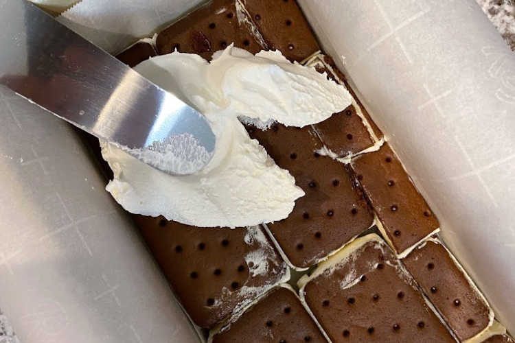 spread whipped topping over ice cream sandwiches