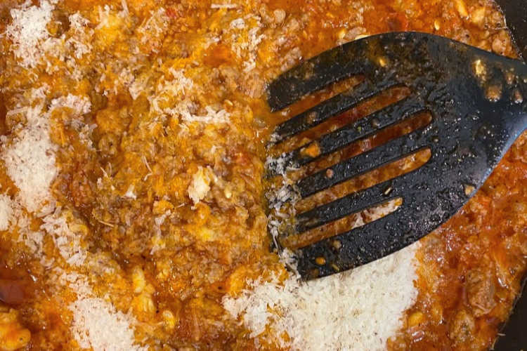 sausage in marinara sauce with parmesan cheese in skillet