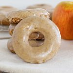 glazed apple spice cake donut with apples on the table
