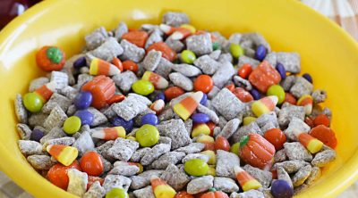 bowl of chex cereal puppy chow with fall and halloween candy