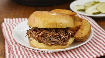 instant pot shredded bbq beef sandwich on a plate with steak fries