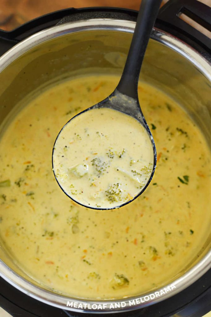 broccoli cheese soup in ladle over instant pot
