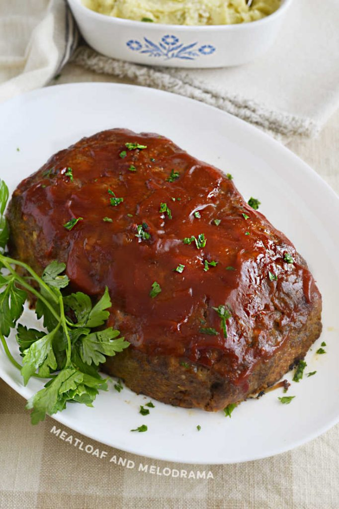 ketchup glazed meatloaf on a white platter
