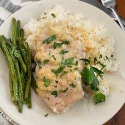 boneless crock pot pork chop on plate with green beans and rice