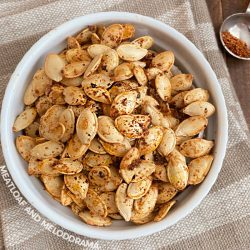 spicy roasted pumpkin seeds with taco seasoning in a white bowl