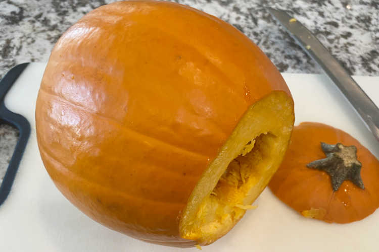sugar pumpkin with top cut off on the counter