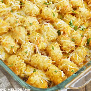 taco tater tot casserole with cilantro in a baking dish