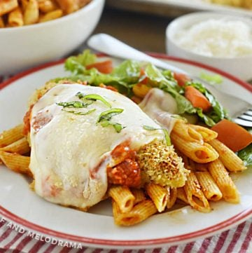 baked chicken parmesan over penne on a plate