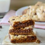 stack of chocolate chip cookie bars with milk