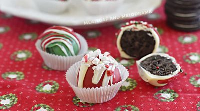 red, green and white decorated Christmas oreo cookie balls on table