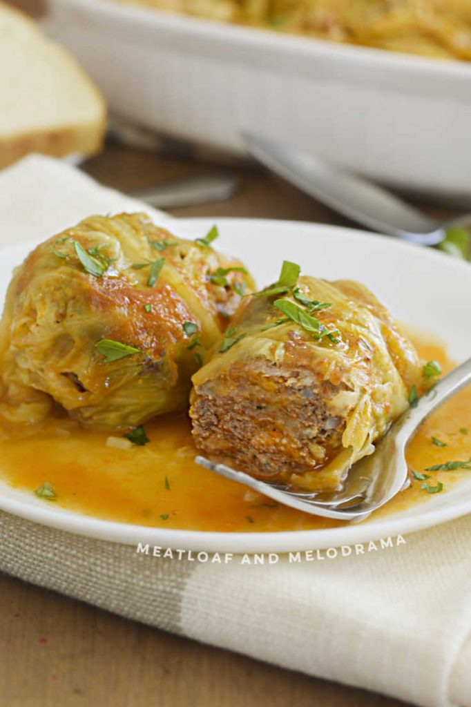 cut open cabbage rolls on a plate with fork